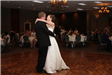 Newlyweds dance together during a wedding reception