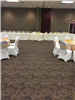 Tables and chairs are set up for a reception