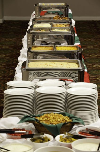 Plates and food set up for a buffet