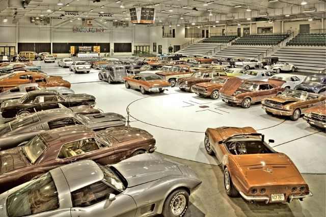 Arena set up for car show with vintage cars