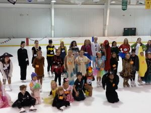 Children in costumes pose together